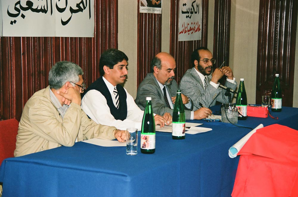 September 7, 1990  Speakers (from left) Dr. Abdulmohsen Jamal, Adel Al-Kharafi, Dr. Mohamed Al-Rumaihi, and Dr. Nasser Al-Sane at the first meeting of the Kuwaiti People's Movement