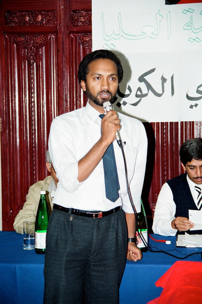 September 7, 1990  Audience member Abdulrahman Al-Obaidly, Head of the Kuwaiti High Committee, speaking at first meeting of the Kuwaiti People's Movement. Behind him (on right) is Adel Al-Kharafi.