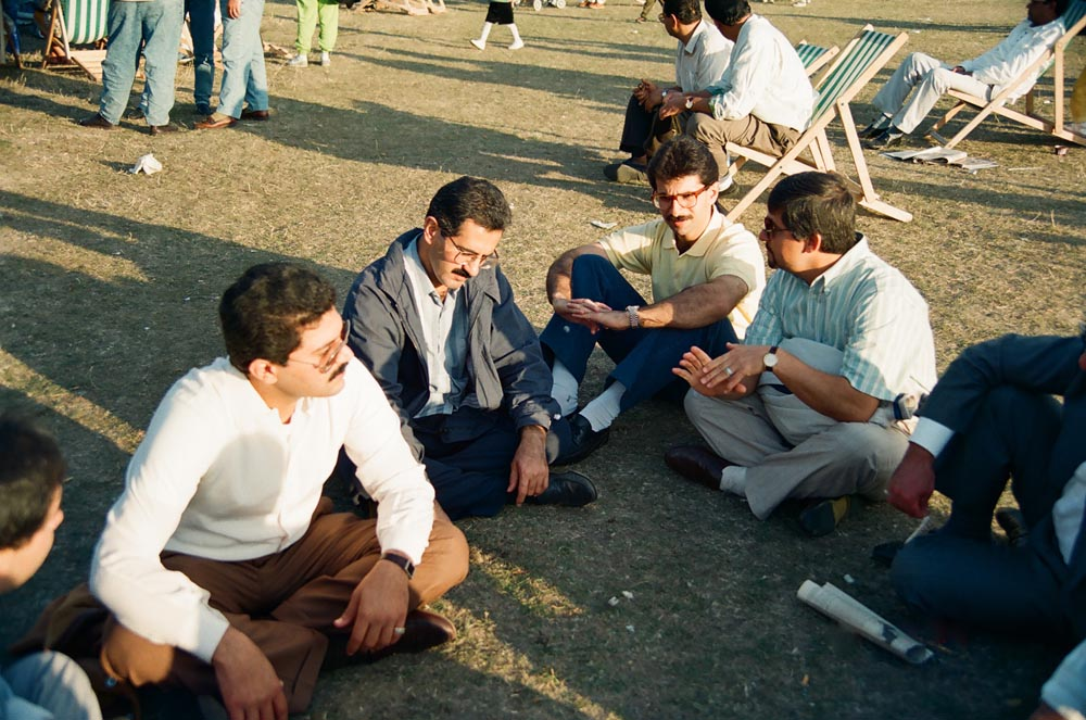 September 9, 1990  As the shock of the invasion wore off, Kuwaitis continued meeting in Hyde Park every Sunday to express solidarity with their legitimate government and to mobilize a movement to free their nation from the Iraqi regime's aggression. In the center (from left) are Farouk Abdulrahim and his brother Hesham Abdulrahim. (See also .)