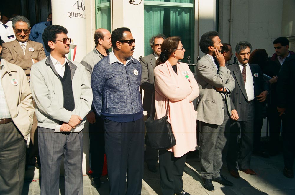 October 7, 1990  Standing outside their Embassy (from left) Dr. Hmoud Al-Ruqba, Sheikh Khalid Al-Ahmad Al-Sabah, Sheikha Dr. Suad Al-Sabah, Abdulraham Al-Obaidly, and Ambassador Ghazi Al-Rayes at the second major march and rally