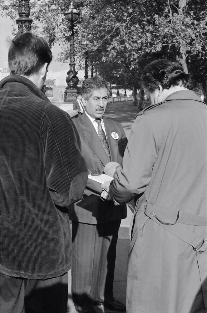 November 2, 1990  Ambassador Ghazi Al-Rayes speaking to the news media at the morning event, which was the first of 3 main events in London. The activities, the largest ever undertaken, marked the invasion's 3-month anniversary and were nationwide. Simultaneous with the 3 London events, volunteers all over the UK distributed buttons, stickers, leaflets, and Friends of Kuwait application forms throughout the day. Students from at least 120 universities, colleges, and polytechnics took part to cover more than 200 cities and towns. London alone had more than 1,000 volunteers who spent the day at all major tube stations, shopping malls, and the city center.
