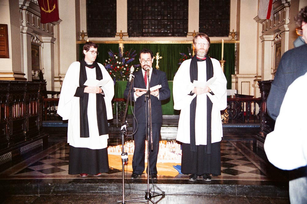 November 2, 1990  Adel Al-Ali, who presided at the ceremony, reading from the Qur'an. He is flanked by Reverend Martin Henwood (left) and Reverend John Pridmore (right), both of St. Martin-in-the-Fields.