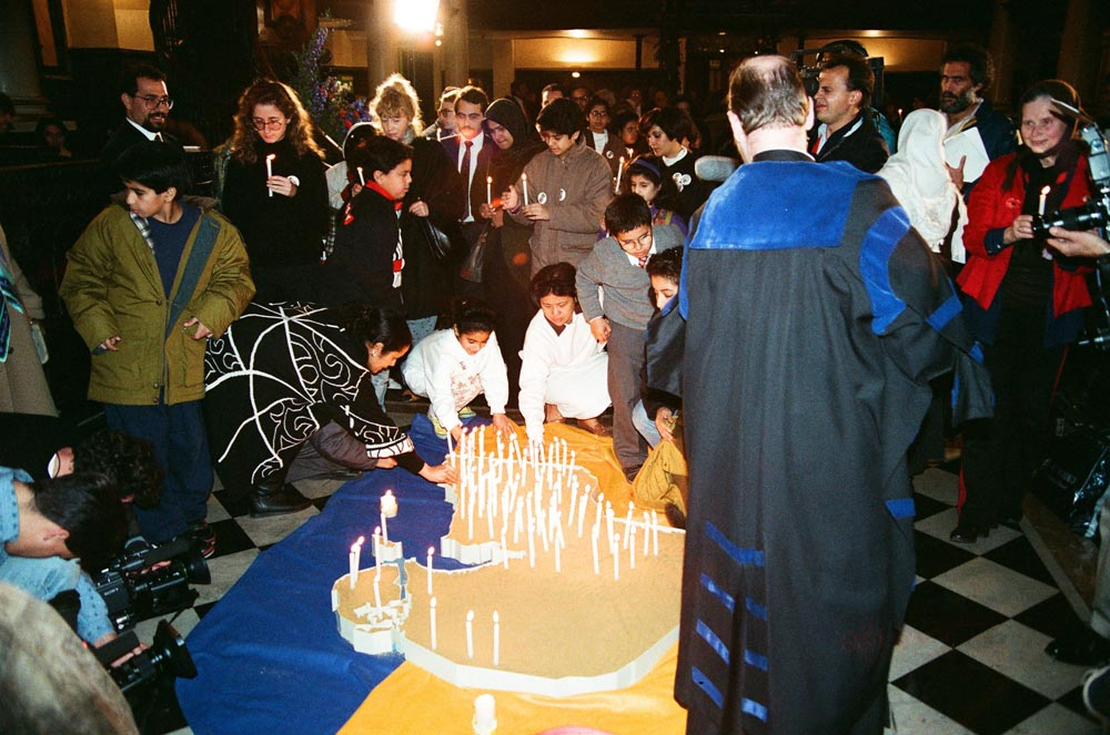 November 2, 1990  Candle-lighting ceremony at St. Martin-in-the-Fields, with each candle representing a Kuwaiti family's loss due to the invasion. On the left are Adel Al-Ali and Dina Sultan.