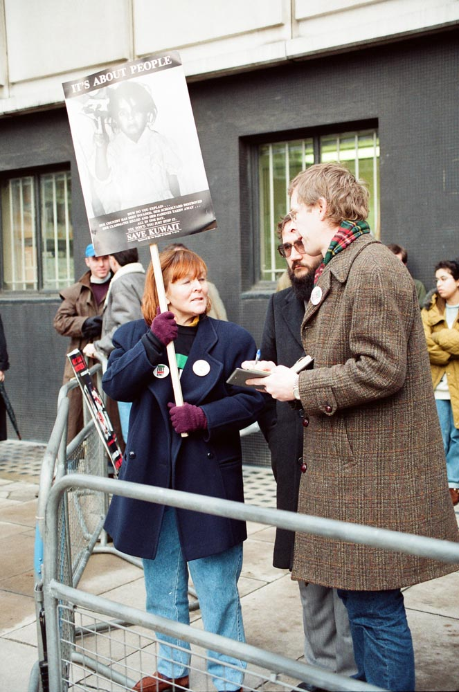 January 2, 1991  A journalist interviewing Carolyn Tshering at the demonstration at the Iraqi Embassy. Basma Al-Naqi (on left) is in the background.
