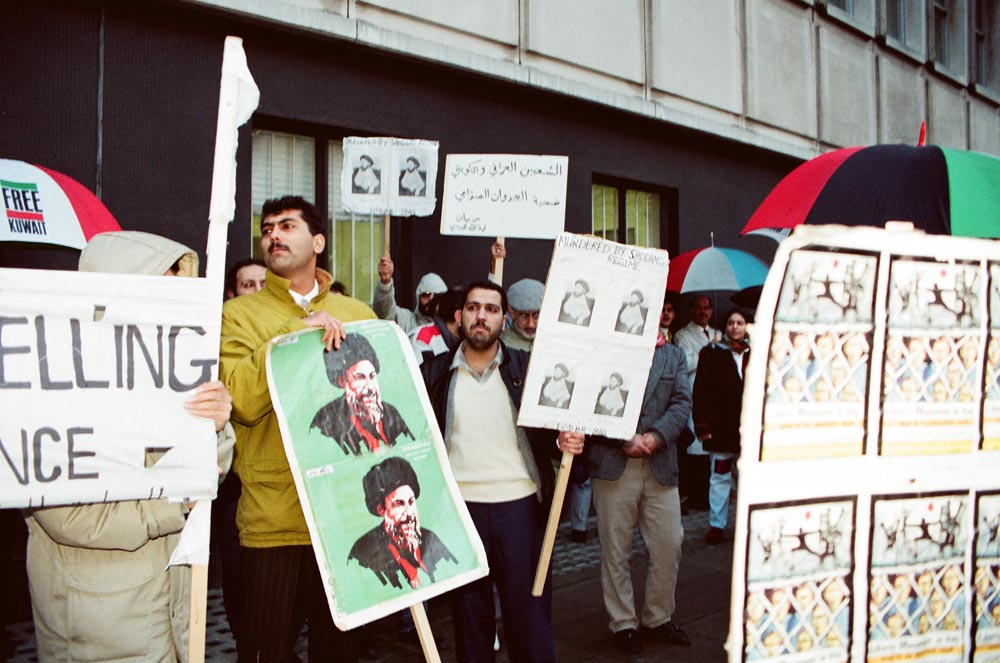 January 2, 1991  Iraqi protestors at the joint Kuwaiti-Iraqi demonstration at the Iraqi Embassy. They displayed photos of Iraqi political prisoners, victims of the regime.