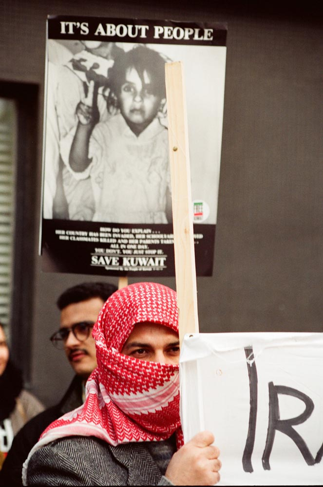 January 2, 1991  An Iraqi protestor at the joint Kuwaiti-Iraqi demonstration at the Iraqi Embassy. To protect family at home from reprisals, he hid his identity.