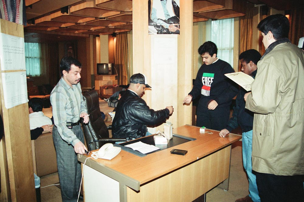 February 6, 1991  Kuwaiti volunteers preparing to join the coalition forces included (on left) Sheikh Majid Al-Sabah. They are checking in inside their Embassy.