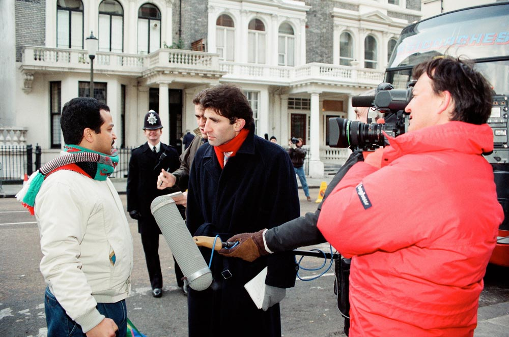 February 6, 1991  A TV journalist interviewing a Kuwaiti volunteer outside the Kuwaiti Embassy before he leaves to join the coalition forces