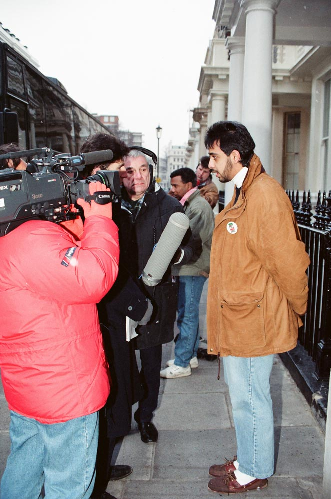 February 6, 1991  Journalists interviewing Sheikh Mohamed Abdullah Mubarak Al-Sabah outside the Kuwaiti Embassy before he leaves to join the coalition forces. In the background Ali Al-Mulaifi is also being interviewed.