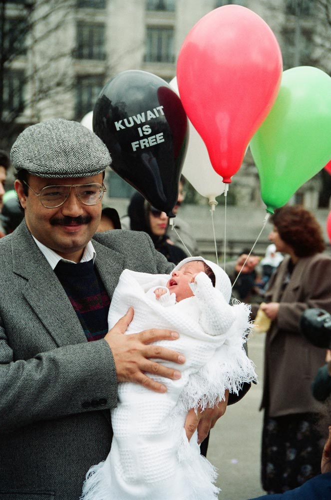 March 2, 1991  Sadiq Jassim Al-Mutawa celebrating liberation with his baby at Marble Arch